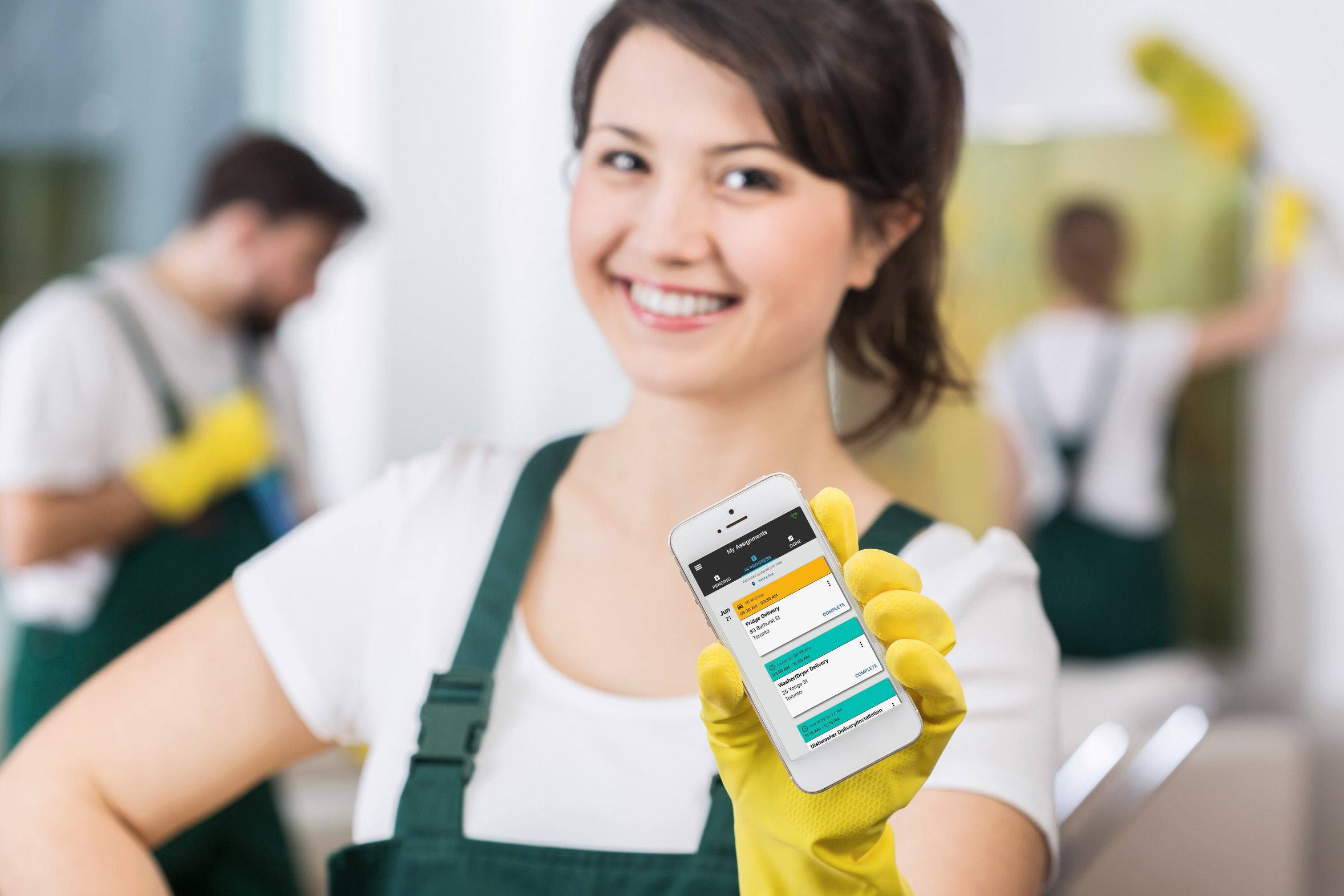 Smiling beautiful girl from cleaning group waiting for call for work
