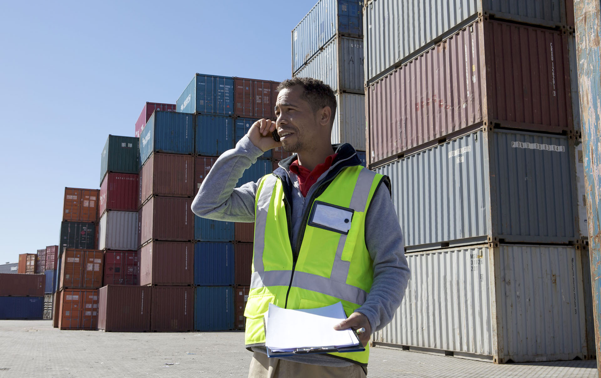 Man in front of shipping containers